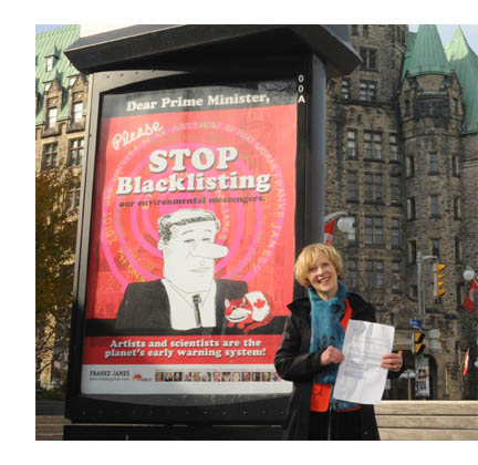 Franke James beside her Dear Prime Minister Please Stop Blacklisting poster is holding a page from the government ATIP document