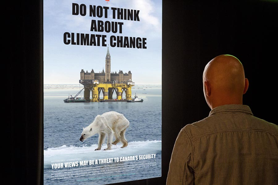 Do Not Think poster by Franke James; Emaciated Polar Bear photo by Kerstin Langenberger, photo of the poster at BCCLA by Zack Embree