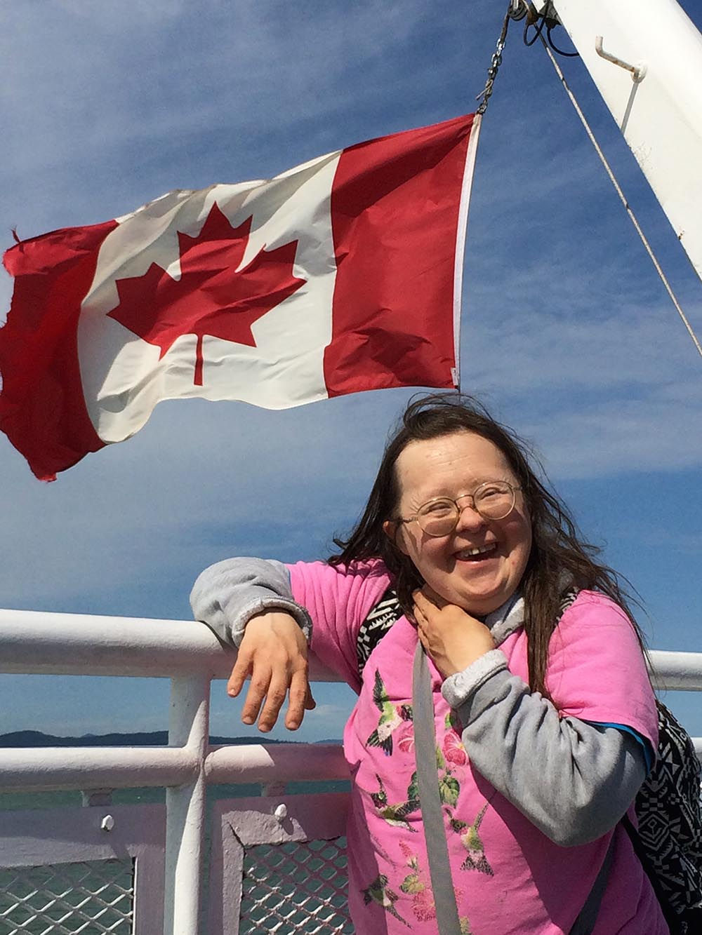 Teresa with Canadian flag on BC ferry