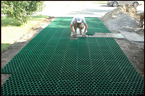 Bill James laying permaturf pavers; photo by Franke James
