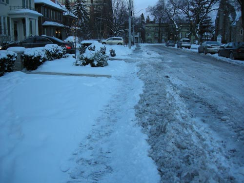 Sidewalk in front of heated driveway home