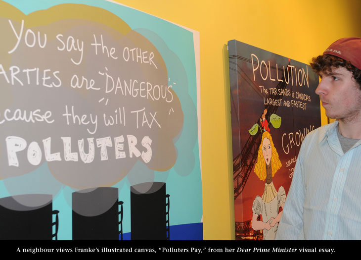 Neighbour views Franke James' canvas about Polluters Paying, photo by James Coburn, Central Image Agency