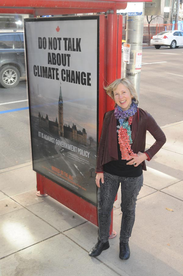 Franke James with Do Not Talk Poster on October 31, 2013, Location 9th Ave Second Calgary, photo by Billiam James